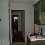 Kitchen before, looking towards upstairs hallway