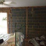 drywall and furring strips removed on exterior wall so stud wall could be built with insulation