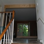 Stairway looking towards living room, wall has been completely removed, structural beam in place