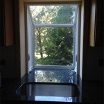 new garden window with granite countertops which extend into window