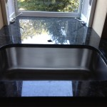 new garden window and under mount sink with granite countertop which extend into window