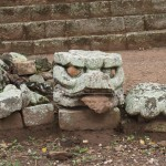 Carved head with tongue in Copan ruins