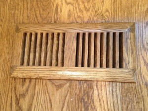 Wooden vent cover stained and sealed to match the hardwood floor
