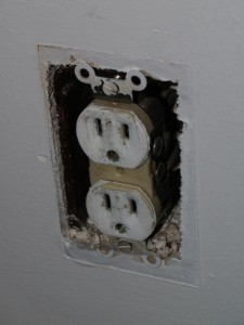 Outlet after cover that was painted while on wall was removed