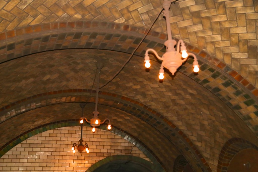 Chandeliers hang from each platform arch