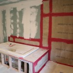 Drywall on walls and Hardiboard in shower