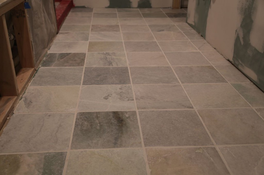 Bathroom floor tile grouted, closer view
