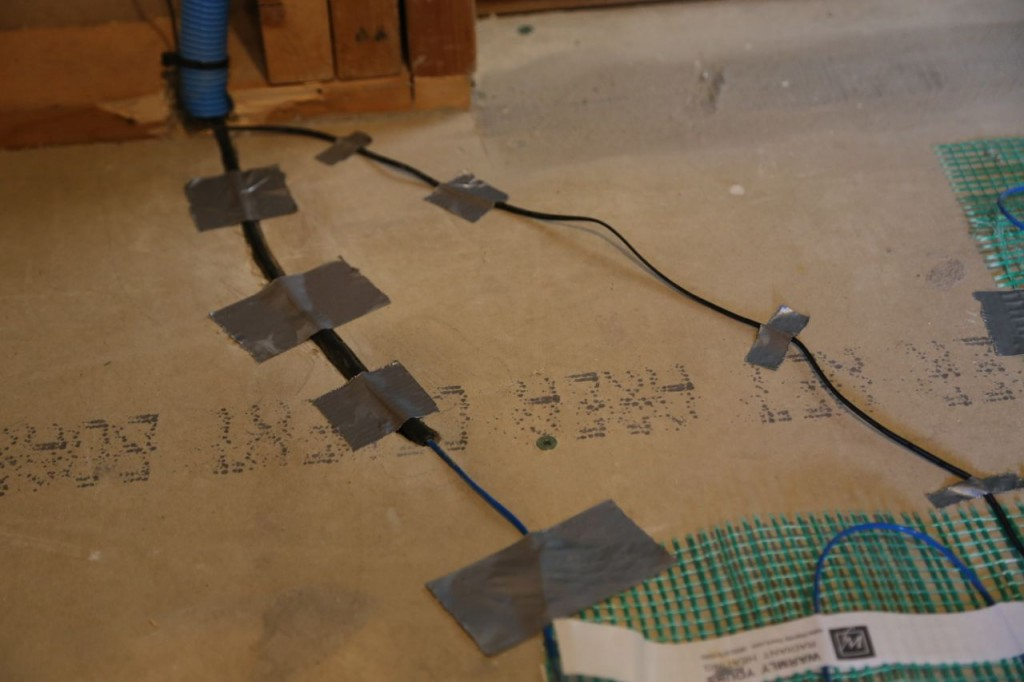 Wiring connecting the radiant heat to the thermostat in wall. I bored a canal for it to lay flat.