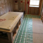 Radiant heat installed down walkway but not where vanity will be on right.