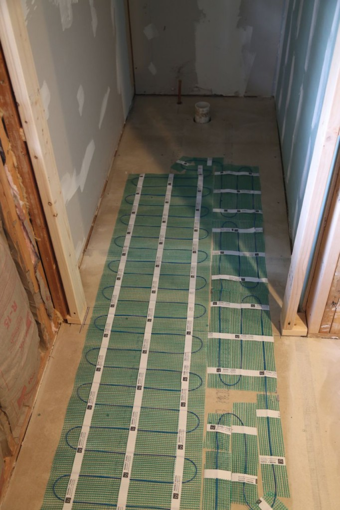Radiant heat installed down walkway but not where toilet will be.