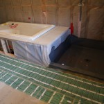 Radiant heat installed down walkway. Tub and shower liner have been installed.