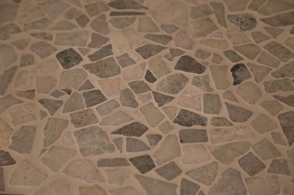 Shower floor tile grouted, closer view