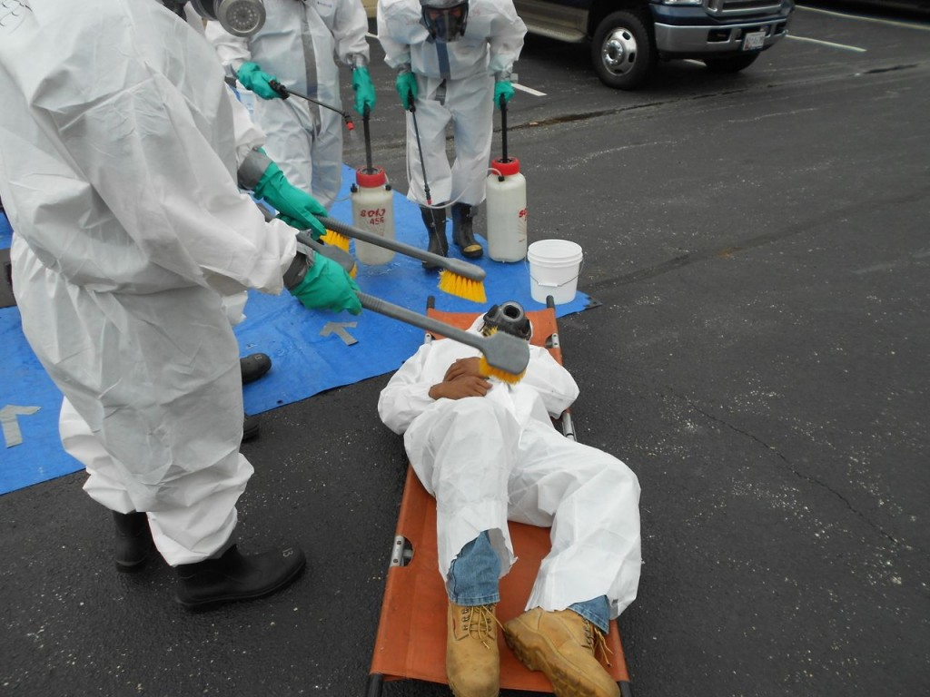 Emergency decontamination of an incapacitated worker
