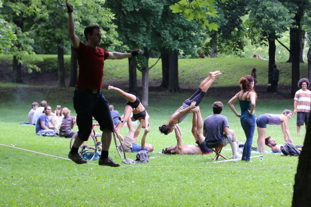 Tightrope walker with yoga gymnasts in background