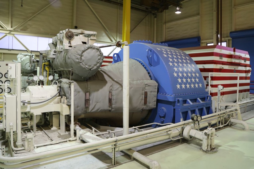 The turbine (gray and blue) and the generator (red and white stripes)