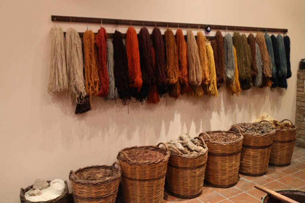 Dyed wool threads and dyeing material