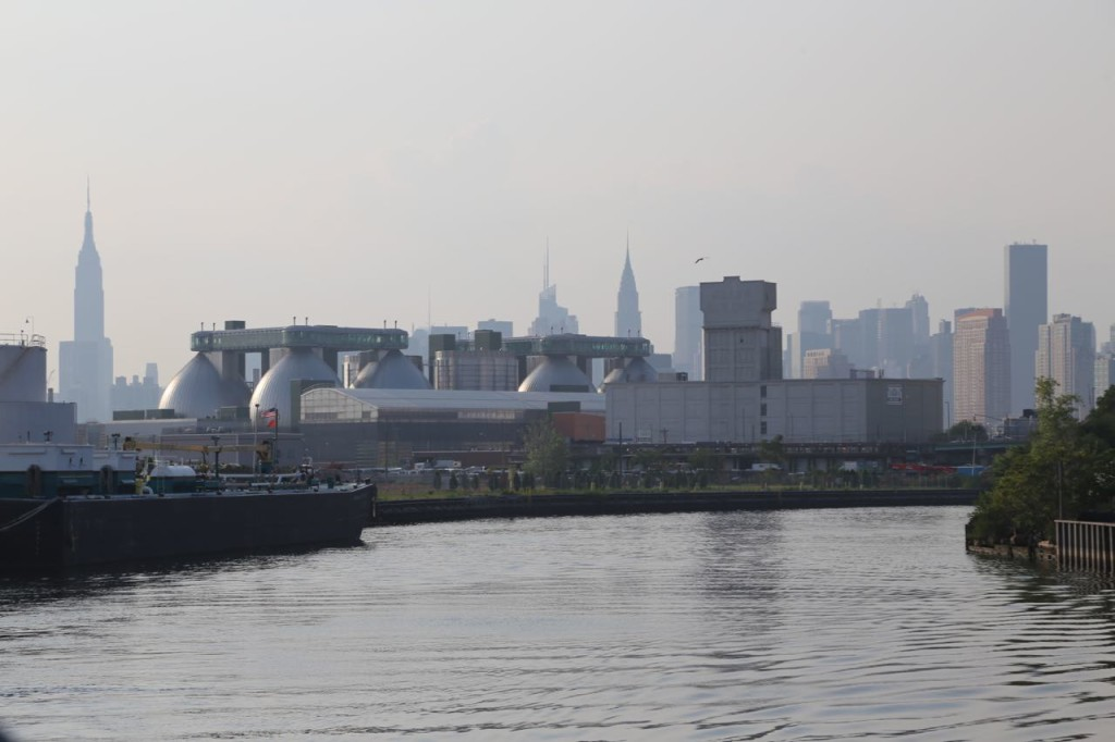 Manhattan skyline behind Newtown Creek Wastewater Treatment Plant