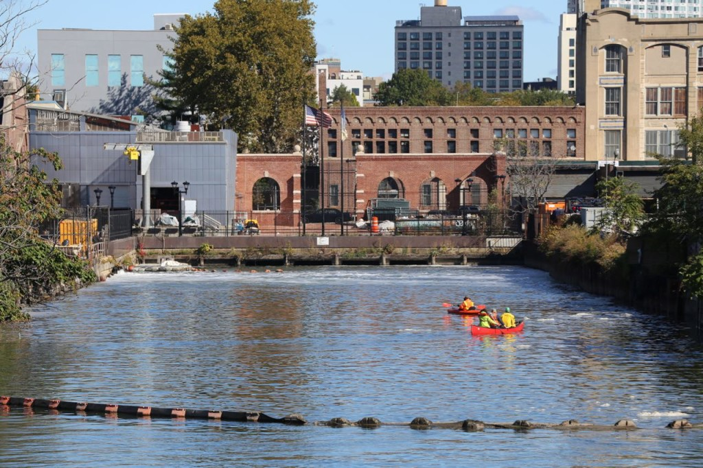Mr. Swain and his support crew paddled to the start of the Gowanus Canal before he entered the water.