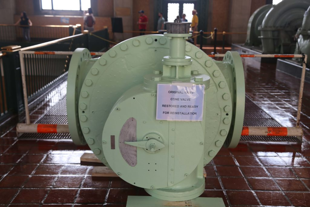 "Sign reads ""Original 1950s cone valve restored and ready for reinstallation"