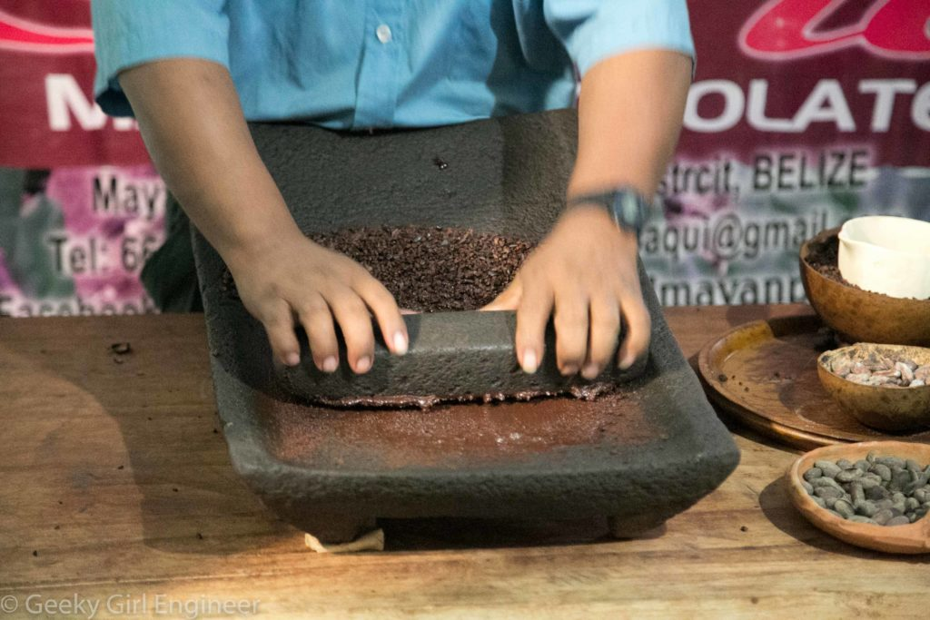 Crushing cacao nibs with liquid starting to form