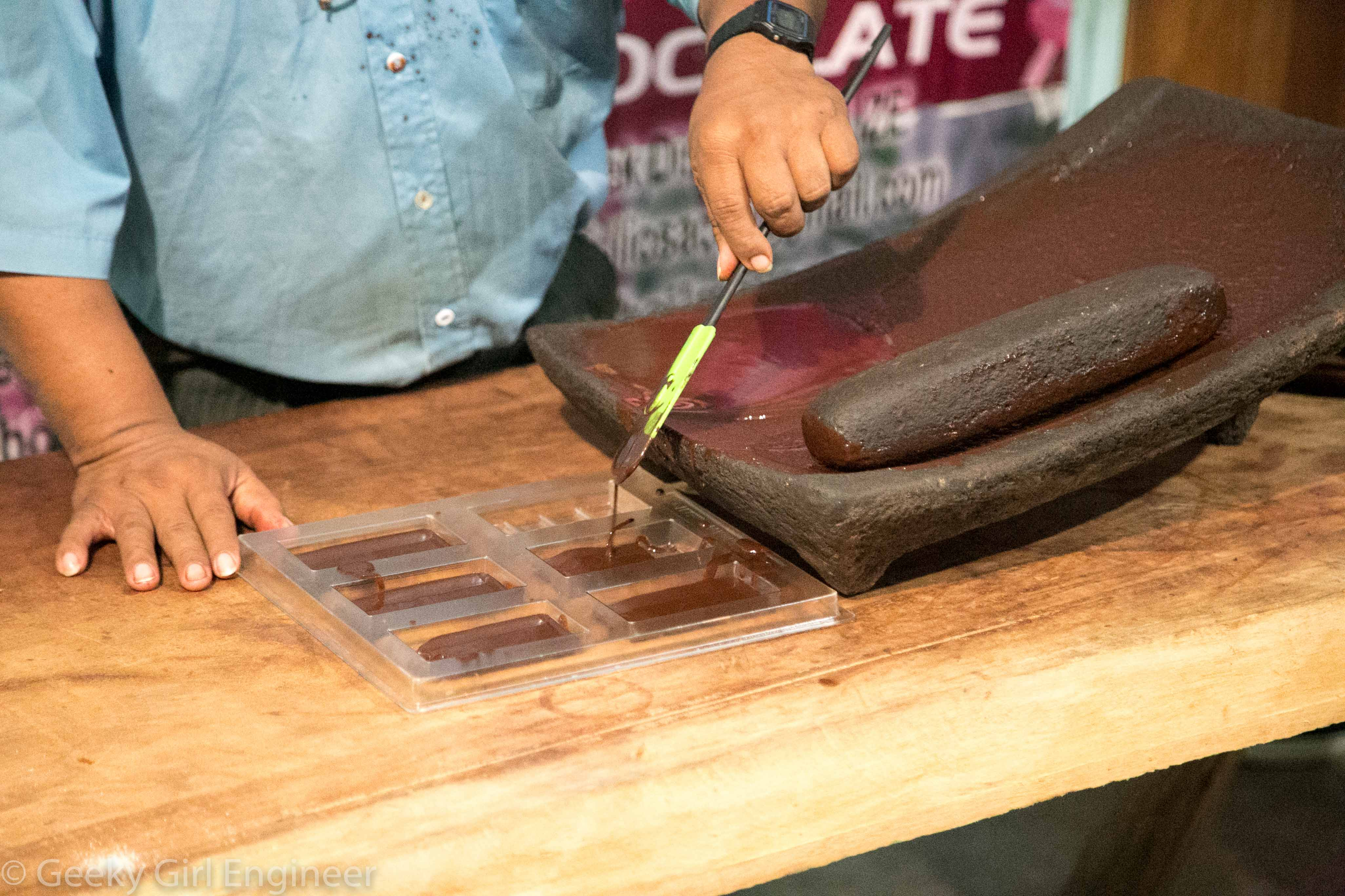 Pouring chocolate into forms