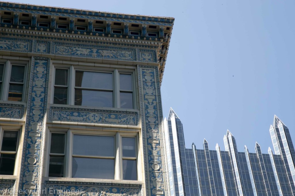 Old tiled building juxtaposed with PPG glass building